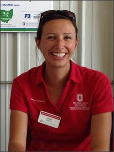 Mary Griffith wearing OSU Polo and name tag, smiling brightly